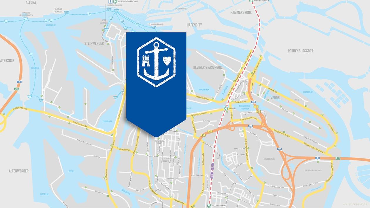 Ausschnitt einer markentypischen Karte von Wilhelmsburg mit Bildmarke