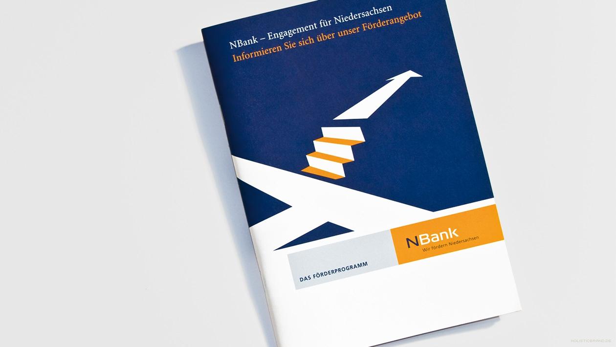 Fotografie eines Broschürentitels mit Illustration